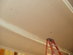 Paint on the ceiling, primer on the beams